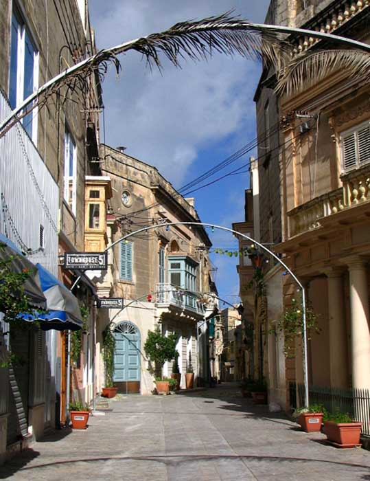 Being situated in the Mediterranean Sea, the island of Malta of course has a long human history. Here is a photo of an old but relatively recent street scene in the town of Rabat, where the bones were discovered.