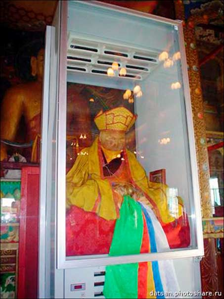 Normally lama Itigilov sits inside the special glass sarcophagus located on the second floor of his 'palace'.