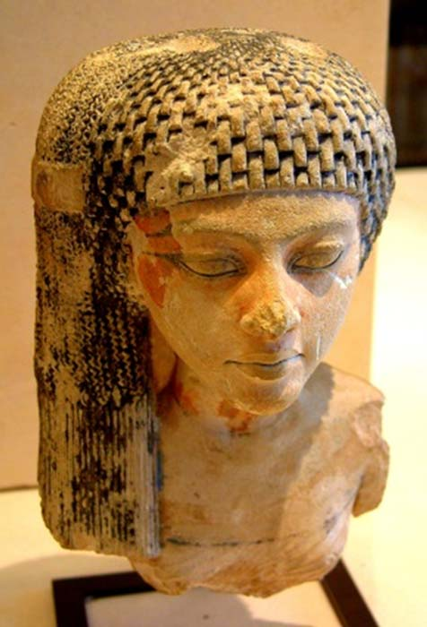 A limestone bust from Amarna that is believed to depict Princess Meritaten. Musée du Louvre, Paris.