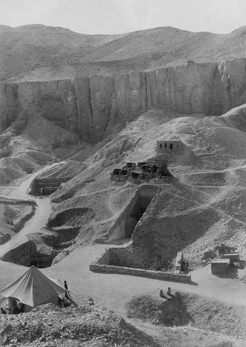 The location of KV62 (Bottom right of image) that lay undisturbed beneath debris from the tomb of Ramesses VI (Nineteenth Dynasty) over which ancient workmen's huts were built. This image shows the site of Tutankhamun's tomb soon after its discovery in 1922. (Public Domain: Harry Burton. Griffith Institute, Oxford)