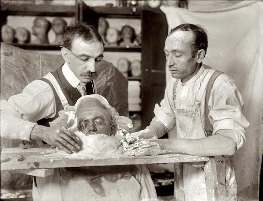 Two men making a death mask