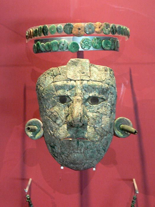 Mask of the Red Queen from the tomb found in Temple XIII The diadem and mask are made of pieces of jade and malachite.
