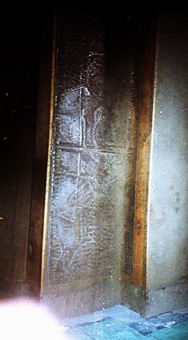 Photo of metal plate of Father Crespi's Collection used to line walls.