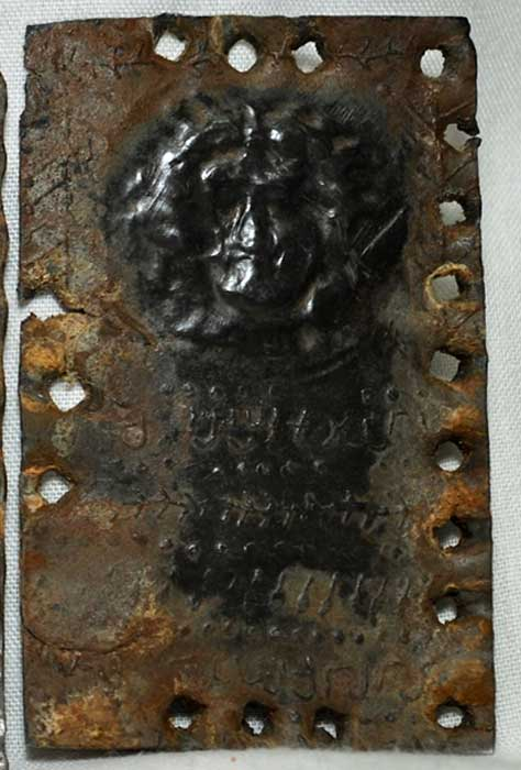 The metal tablet which may be a portrait of Jesus.