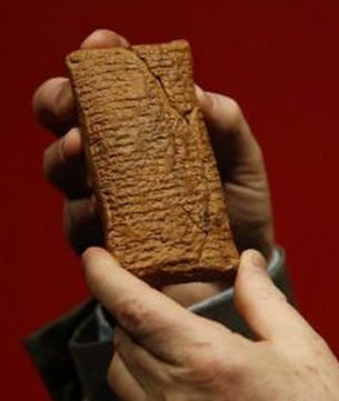 miniscule text engraved on clay tablets