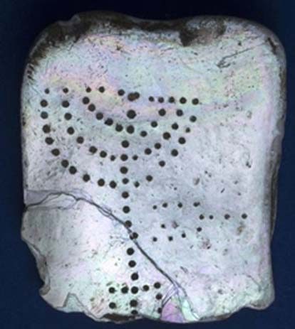 Experts say the mother-of-pearl tablet with the menorah found in the ancient harbor town of Caesarea is evidence of a Jewish presence from the 4th or 5th centuries AD.