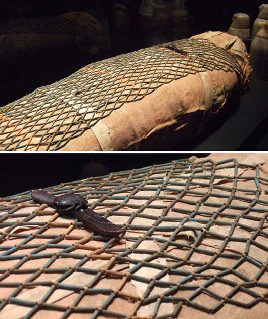 A mummy covered in a bead-net