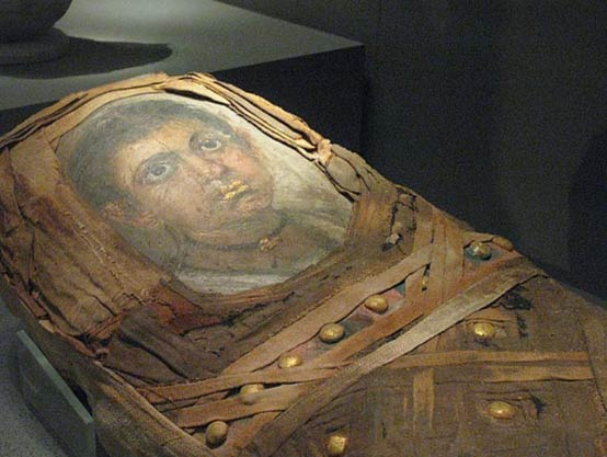 A mummy portrait attached to a sarcophagus