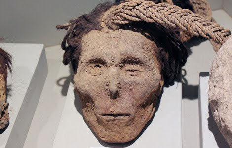 Nazca trophy head with the carrying rope