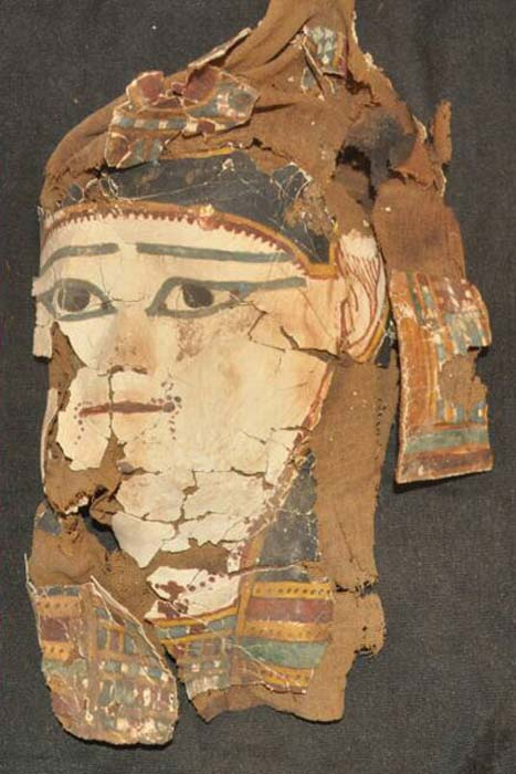 A painted mummy mask found as part of one of the funerary collections.