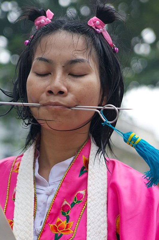 A photo of face piercing from the 2011 Phuket Vegetarian Festival.