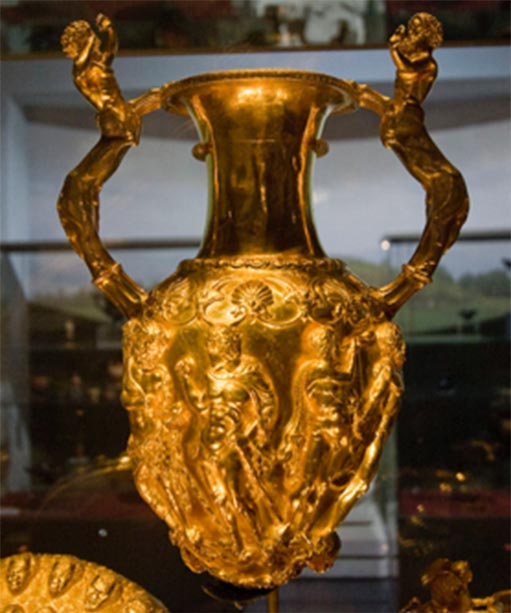 The Panagyurishte Treasure's golden rhytonized amphora. The big amphora has handles shaped as centaurs, and the openings for pouring wine represent African heads. In between those two openings, the amphora is decorated with a scene of Hercules fighting a snake. (Ann Wuyts / CC BY 2.0)