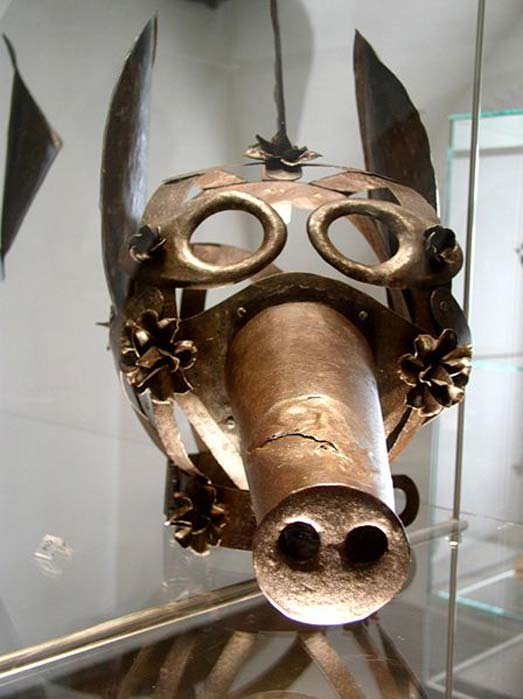 "A medieval ""schandmaske"", or mask of shame, in the Fortress Museum, Salzburg, Austria"