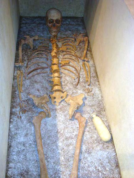 The skeleton of the ancient athlete found at Taranto. He can be seen with the small jar of ointment by his left hand.