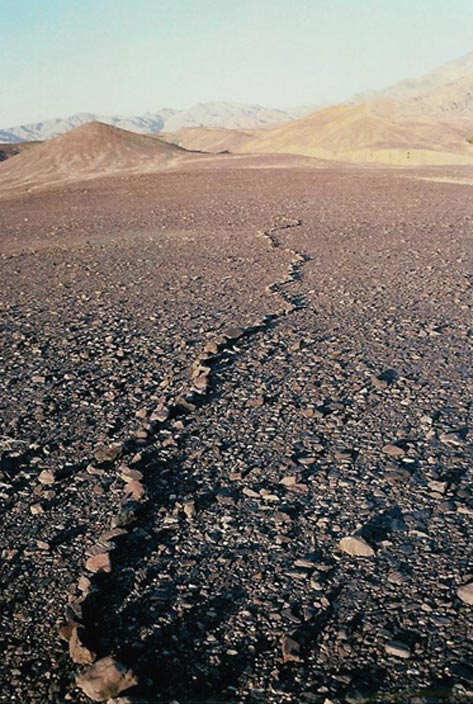 A solitary line of rocks – a petroform relic that tells of the mysterious activity of a long-ago shaman in Death Valley.