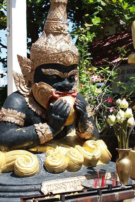 A statue depicting Kala Rau swallowing the sun, the legend being solar eclipses. Thailand.