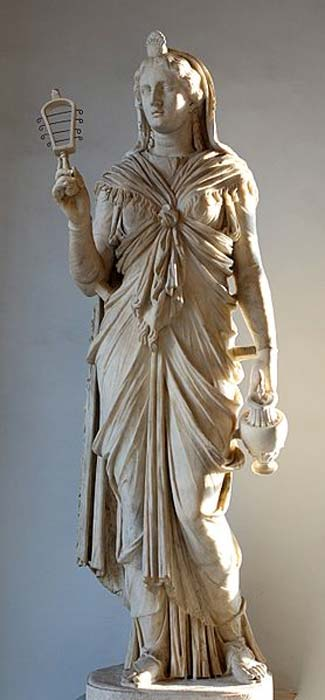 A Roman statue of Isis holding a sistrum and an oinochoe.