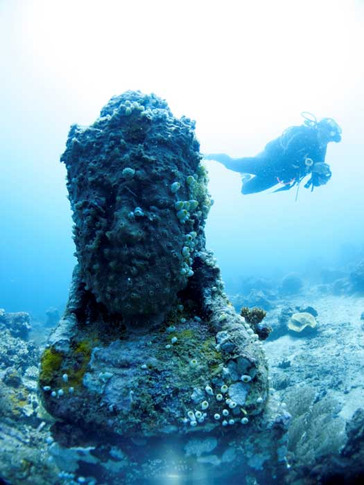 The statues were lowered 29 meters (95 ft) to rest on the seabed