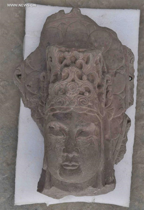 A stone Bodhisattva head unearthed at the excavation site of the Fugan Temple in Chengdu, China