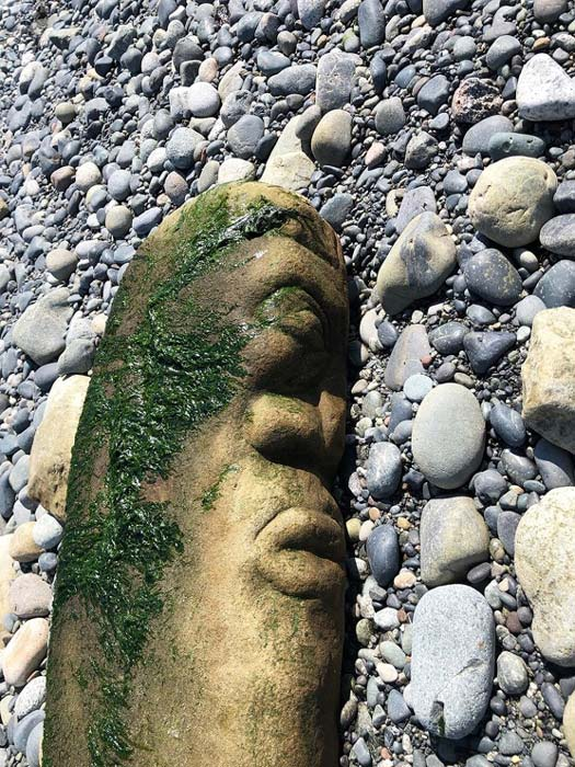 The stone carving was discovered by Bernhard Spalteholz while walking on a beach in British Colombia, Canada. The Canadian artwork has since sparked controversy due to its possible misidentification by an archaeologist at the Royal British Colombia Museum. (Bernhard Spalteholz / Royal B.C. Museum)