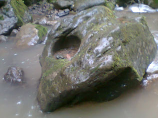 One of the stones with a circular hole