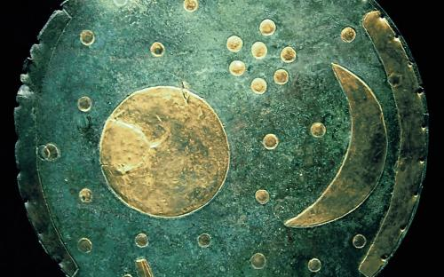 The Nebra sky disk is a bronze disk of around 30 cm diameter and a weight of 2.2 kg, with a blue-green patina and inlaid with gold symbols. (Source: Wikipedia)
