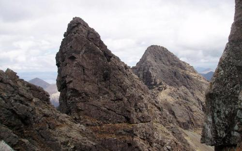 More details The vertical west face of the Bastier Tooth (a top next to Am Basteir) in the Cuillin, with Sgùrr nan Gillean in the background (CC BY-SA 2.0)