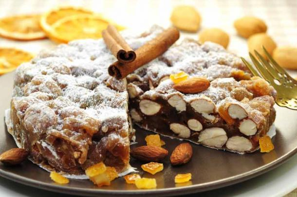 Panaforte is an Italian dessert, a kind of fruitcake, which contains fruits and nuts. (Printemps / Adobe Stock)