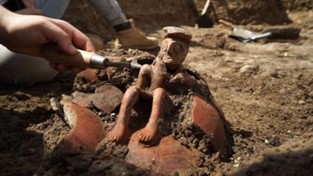 The 3,800-year-old jug when it was exposed in the field. Photographic credit: EYECON Productions, courtesy of the Israel Antiquities Authority.
