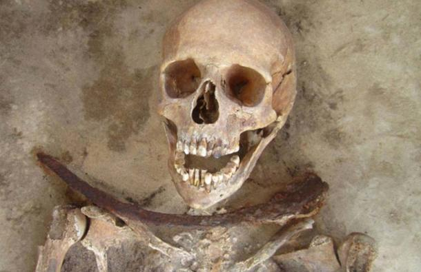 30-39 year old female's remains with iron sickle placed across neck. Lesley A. Gregoricka et al. 2014 (CC BY 4.0)