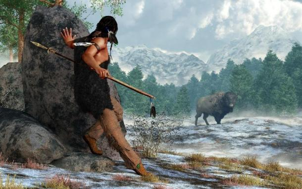 3D Rendering of a prehistoric Native American hunter wearing furs and carrying an atlatl and spear as he stalks a bison in a snow covered valley in the Rocky Mountains. (Daniel /Adobe Stock)