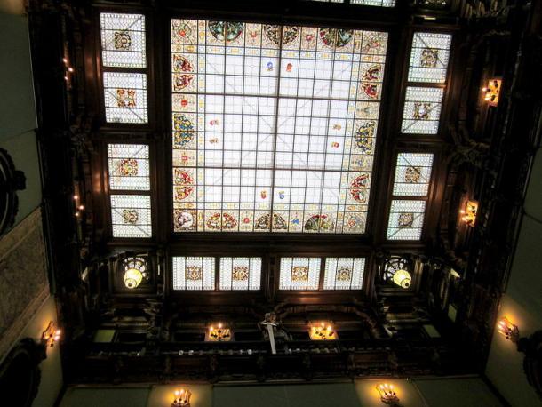 An ornate glass ceiling in Peleș Castle.