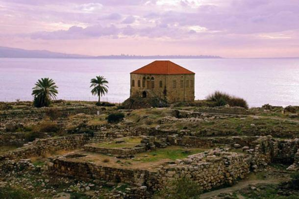 A 19th century Lebanese house amongst ruins on the seafront near Byblos Castle, Byblos, Lebanon.