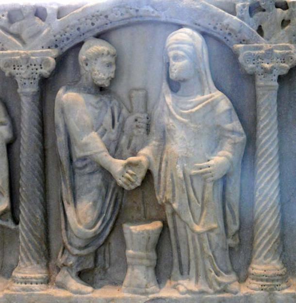 """A 4th century sarcophagus depicting a Roman couple in the ceremonial joining of hands; the bride's knotted belt symbolized that her husband was """"belted and bound"""" to her. Marble, latter part of 4th century. Musée de l'Arles et de la Provence antiques. (Ad Meskens/CC BY SA 3.0)"""