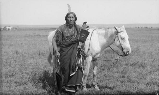 "A Comanche warrior named ""Ako"" and his horse, photographed 1892. (Public Domain)"