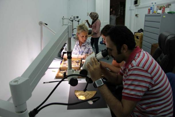 A German-Egyptian team examines objects from the find at the tomb of Tutankhamun.