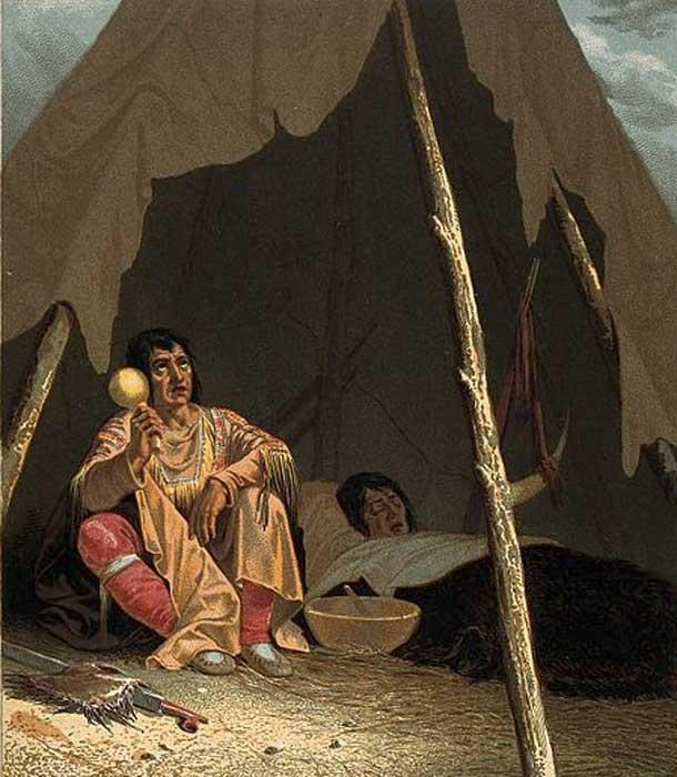 A North American Indian shaman or medicine man healing a patient.