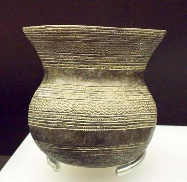 A Prehistoric earthenware vessel, part of a beaker-culture pottery group dated in the early Bronze Age (Europe 1970 and 1470 BC)