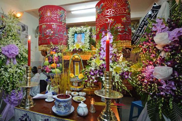 A Vietnamese funeral arrangement. (going slowly)
