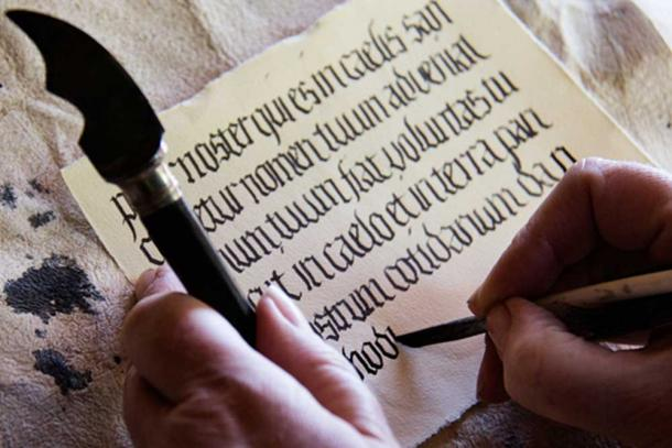 A calligrapher writing in Medieval style text. (CC BY-ND 2.0)