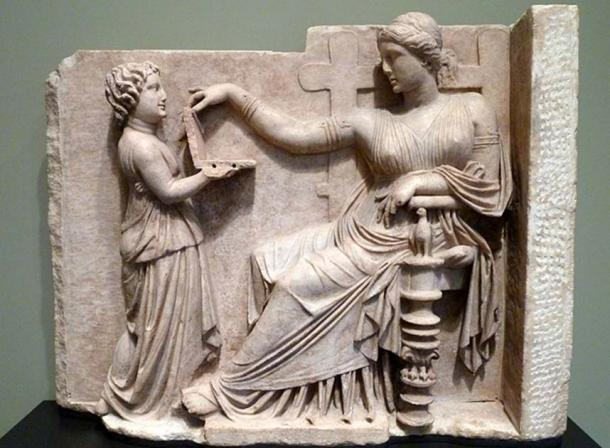 A child showing a woman (Greek, c. 100 BC) a wax writing tablet (CC by SA 2.0)