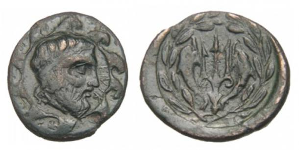 A coin from Helike. Obverse: Head of Poseidon; Reverse: A trident.