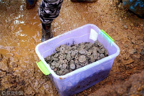 A container showing some of the coins found during construction work on a house in Jiangxi province.