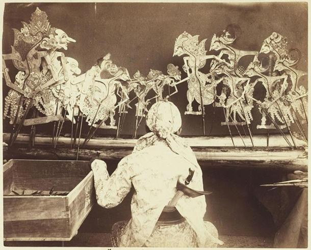 A dalang performing wayang kulit in Java, circa 1890.