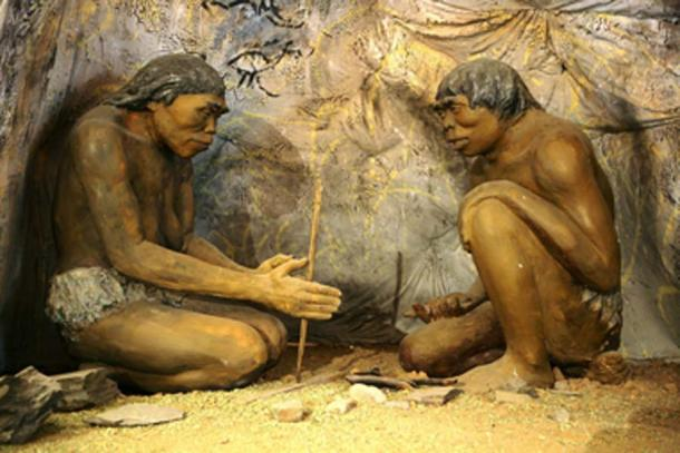 A diorama showing H. erectus, the earliest human species that is known to have controlled fire. (High Contrast / Public Domain)