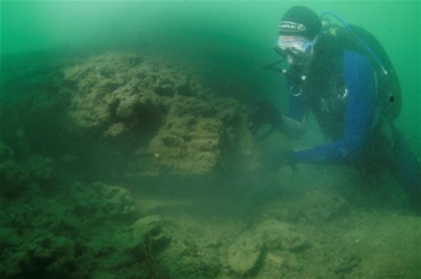 A diver examines the site (NOC)