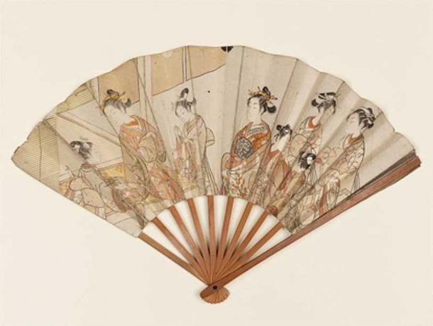 A folding hand fan set with two prints by the Japanese ukiyo-e artist Suzuki Harunobu. (Public Domain)