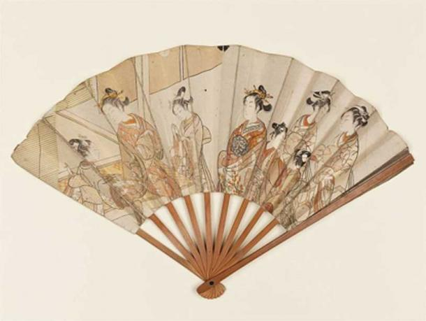 A folding hand fan set with two prints by the Japanese ukiyo-e artist Suzuki Harunobu. (Public Domain)