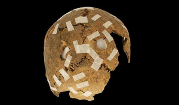 A fragmentary trophy skull with drilled hole modifications. (F. Garrido & C. Morales / Fair Use)