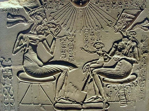A house altar showing Akhenaten, Nefertiti and three of their daughters. 18th dynasty, reign of Akhenaten.